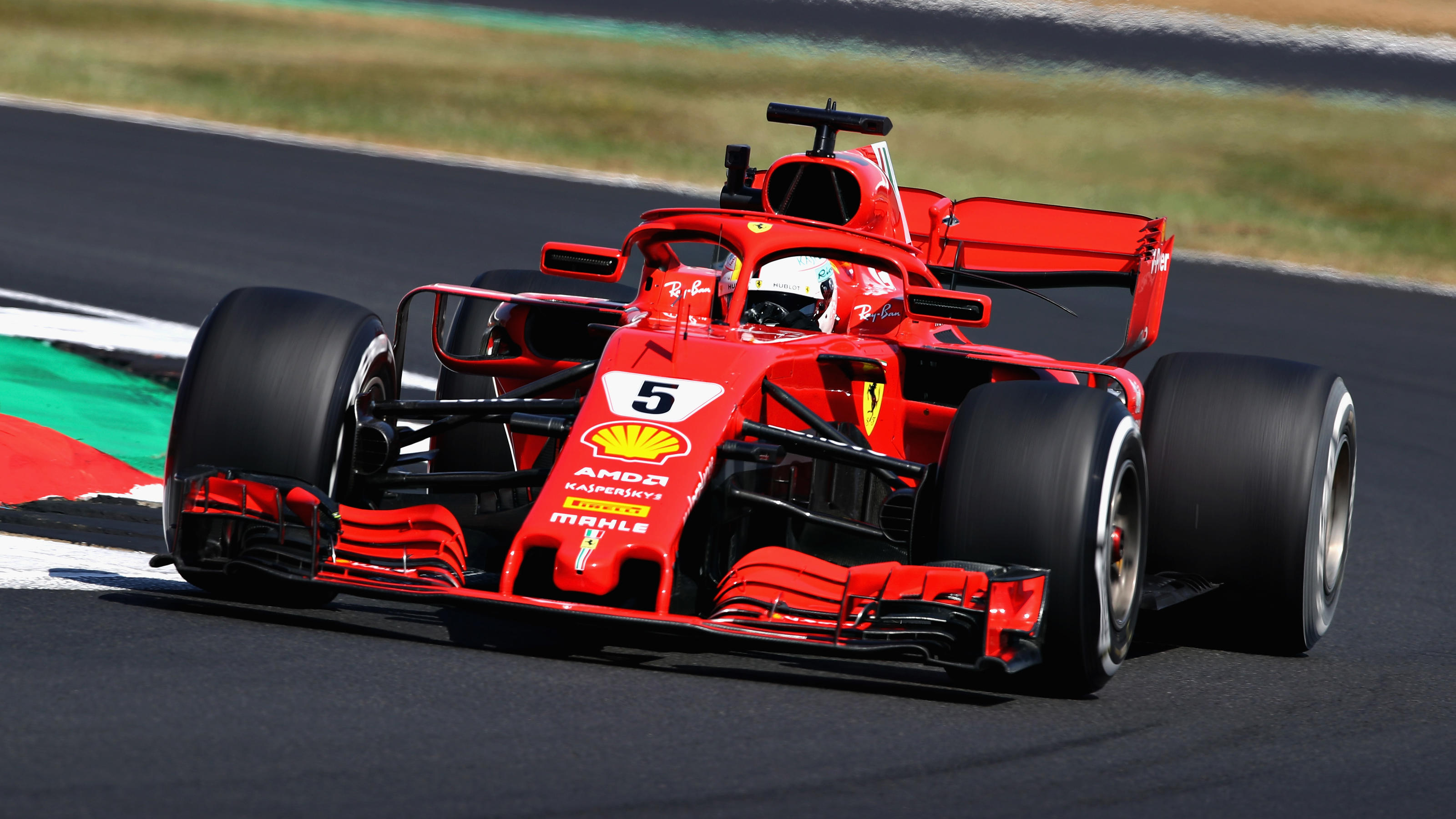 NORTHAMPTON, ENGLAND - JULY 06: Sebastian Vettel of Germany driving the (5) Scuderia Ferrari SF71H on track during practice for the Formula One Grand Prix of Great Britain at Silverstone on July 6, 2018 in Northampton, England.  (Photo by Mark Thomps