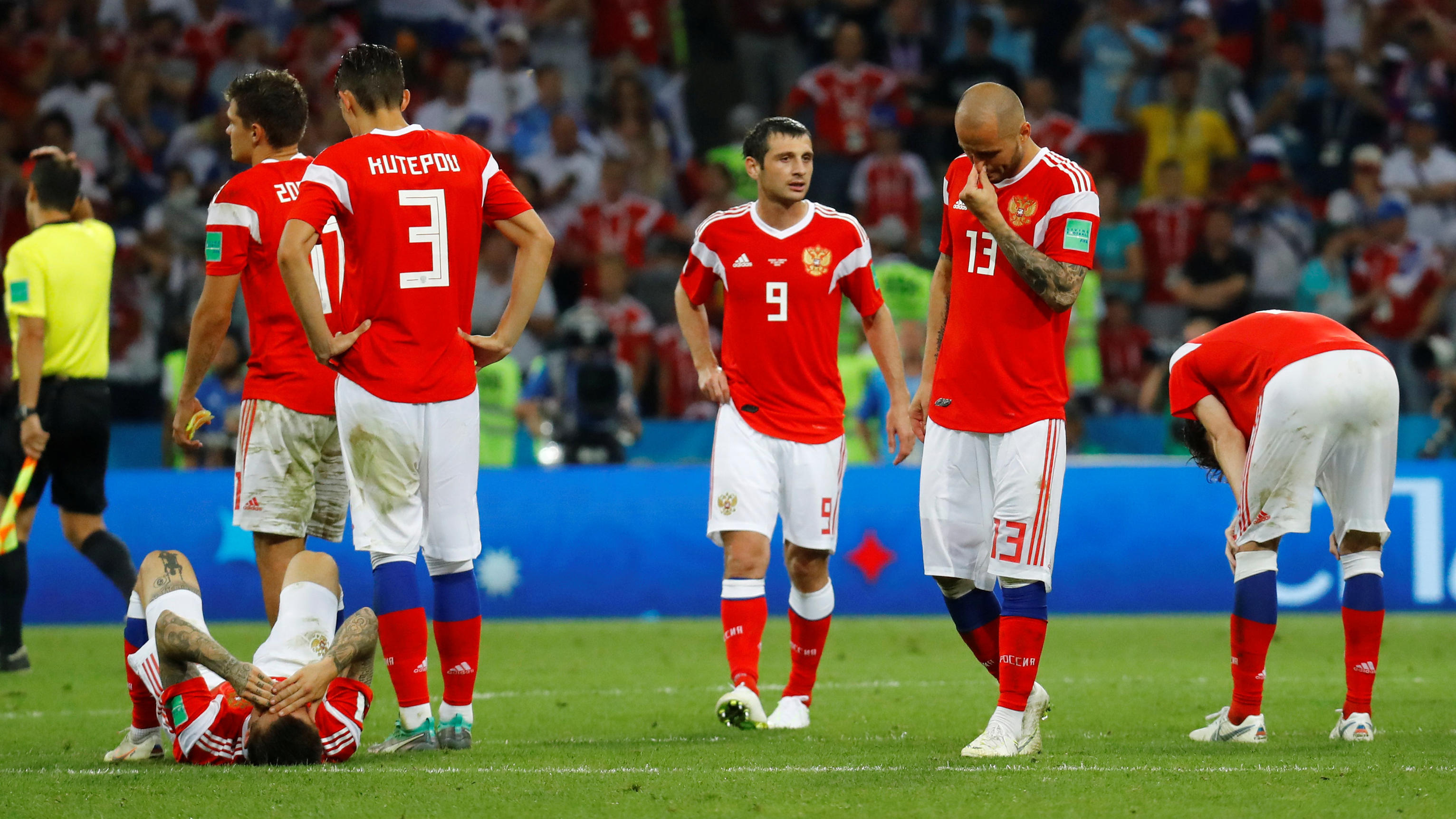 Soccer Football - World Cup - Quarter Final - Russia vs Croatia - Fisht Stadium, Sochi, Russia - July 7, 2018  Russia's Fyodor Kudryashov and team mates look dejected after the match                                              REUTERS/Kai Pfaffenbac