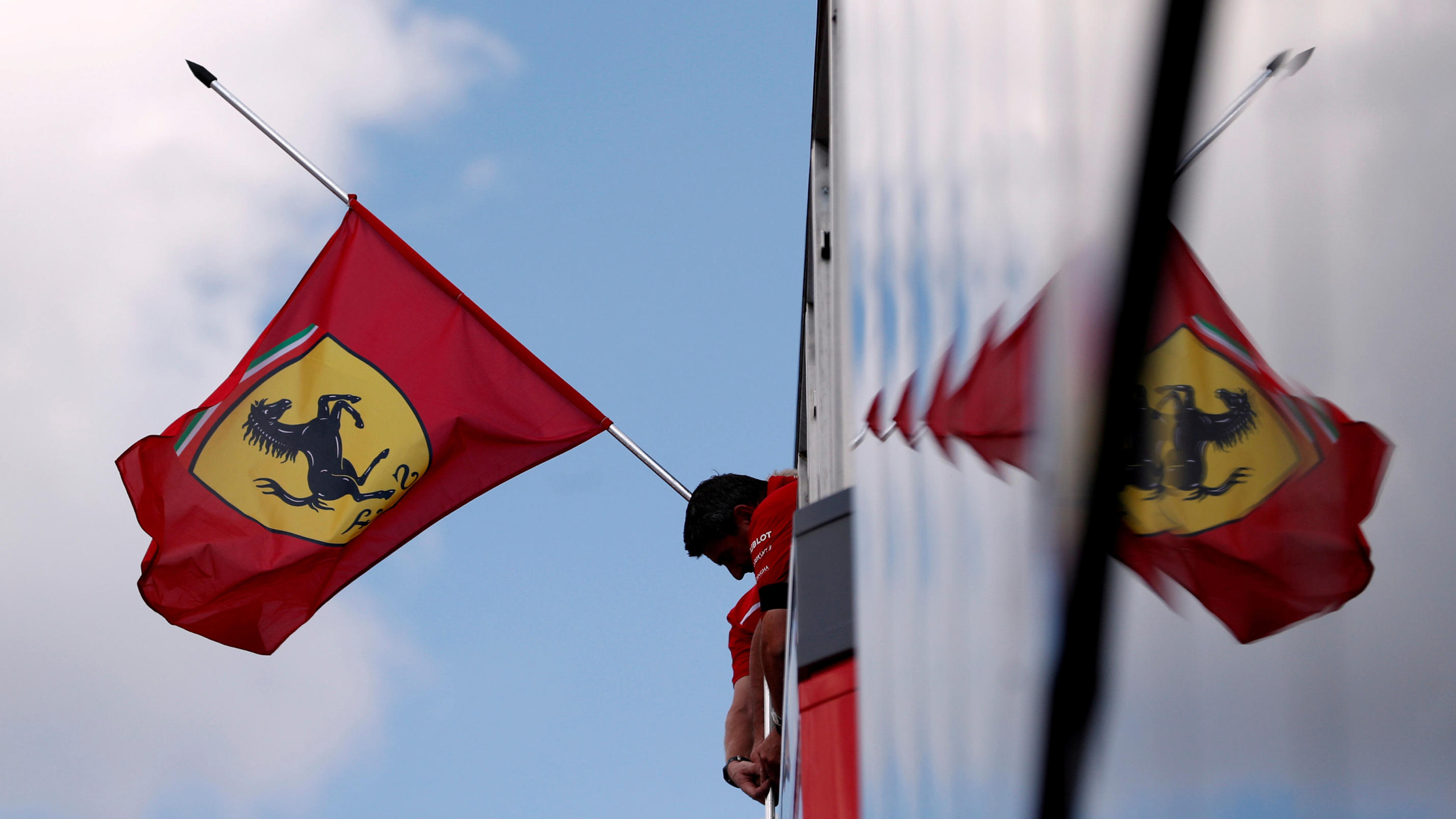 FILE PHOTO: Formula One F1 - Hungarian Grand Prix - Hungaroring, Budapest, Hungary - July 26, 2018   A Ferrari flag flies at half mast in tribute to Former Fiat Chrysler CEO Sergio Marchionne   REUTERS/Bernadett Szabo/File Photo