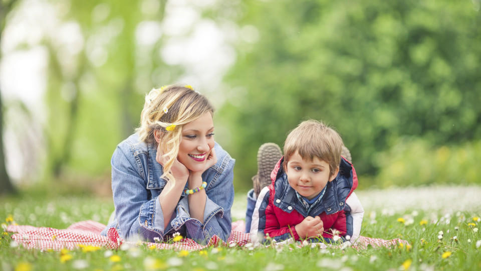 Young family enjoying spring while having a picnic in nature
