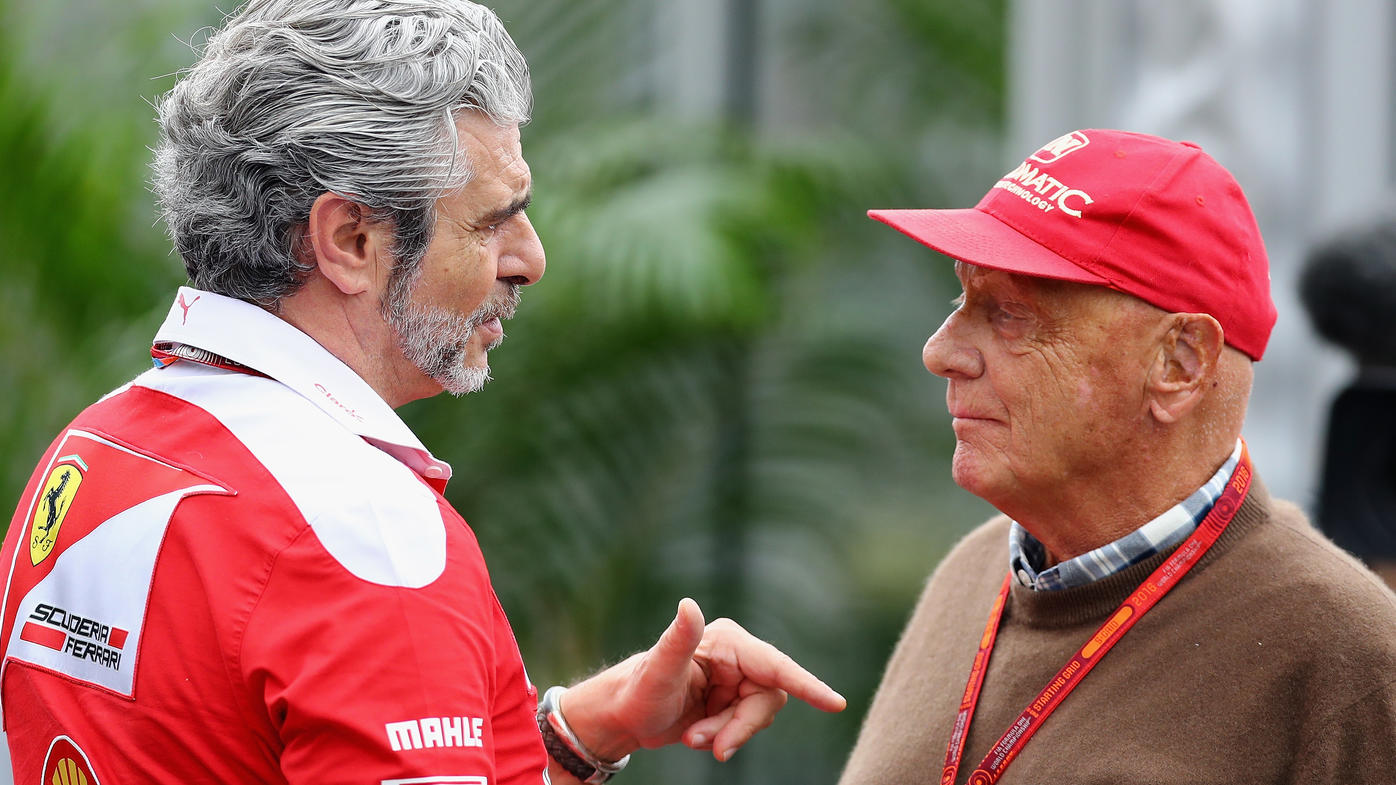 SUZUKA, JAPAN - OCTOBER 08: Ferrari Team Principal Maurizio Arrivabene talks with Mercedes GP non-executive chairman Niki Lauda in the Paddock  during final practice for the Formula One Grand Prix of Japan at Suzuka Circuit on October 8, 2016 in Suzu