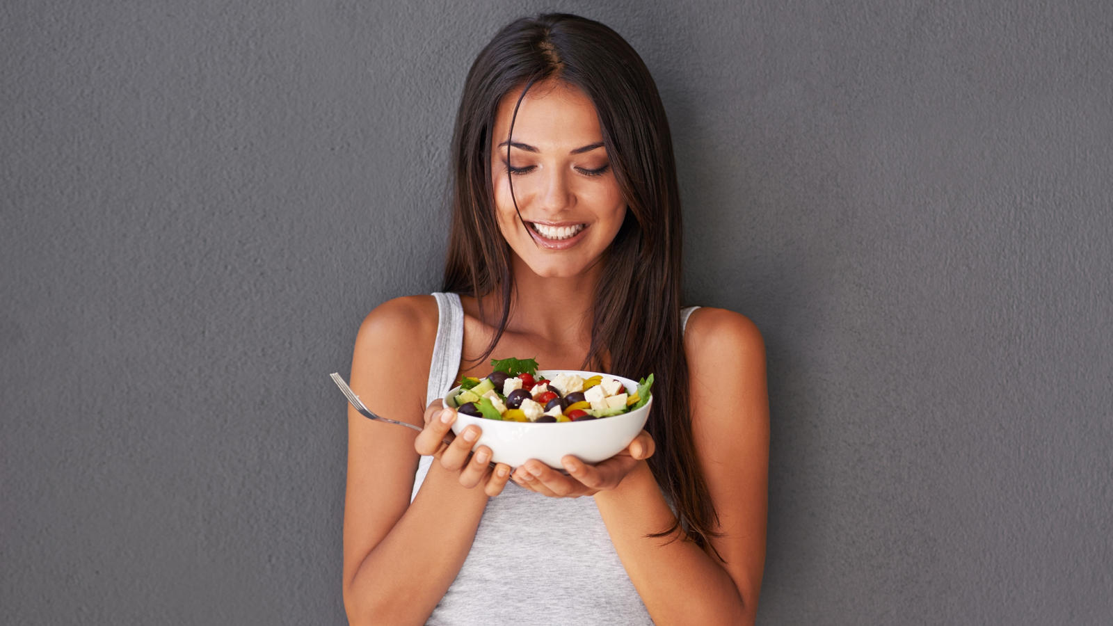 Shot of an attractive young woman looking happy while holding a salad bowlhttp://195.154.178.81/DATA/i_collage/pi/shoots/783751.jpg