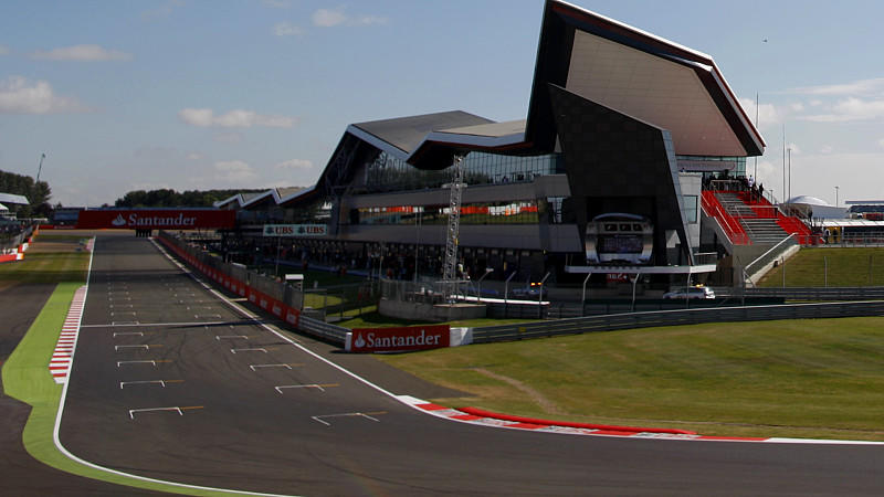 NORTHAMPTON, ENGLAND - JULY 04:  A general view of Club Corner and pit complex during practice ahead of the British Formula One Grand Prix at Silverstone Circuit on July 4, 2014 in Northampton, United Kingdom.  (Photo by Drew Gibson/Getty Images)