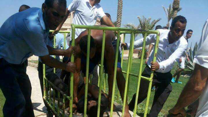 Workers and security detain the man who stabbed two German tourists to death and wounded four others during an attack of the Zahabia hotel resort in Hurghada, south of the capital Cairo, Egypt, July 14, 2017. REUTERS/Mohamed Aly     TPX IMAGES OF THE