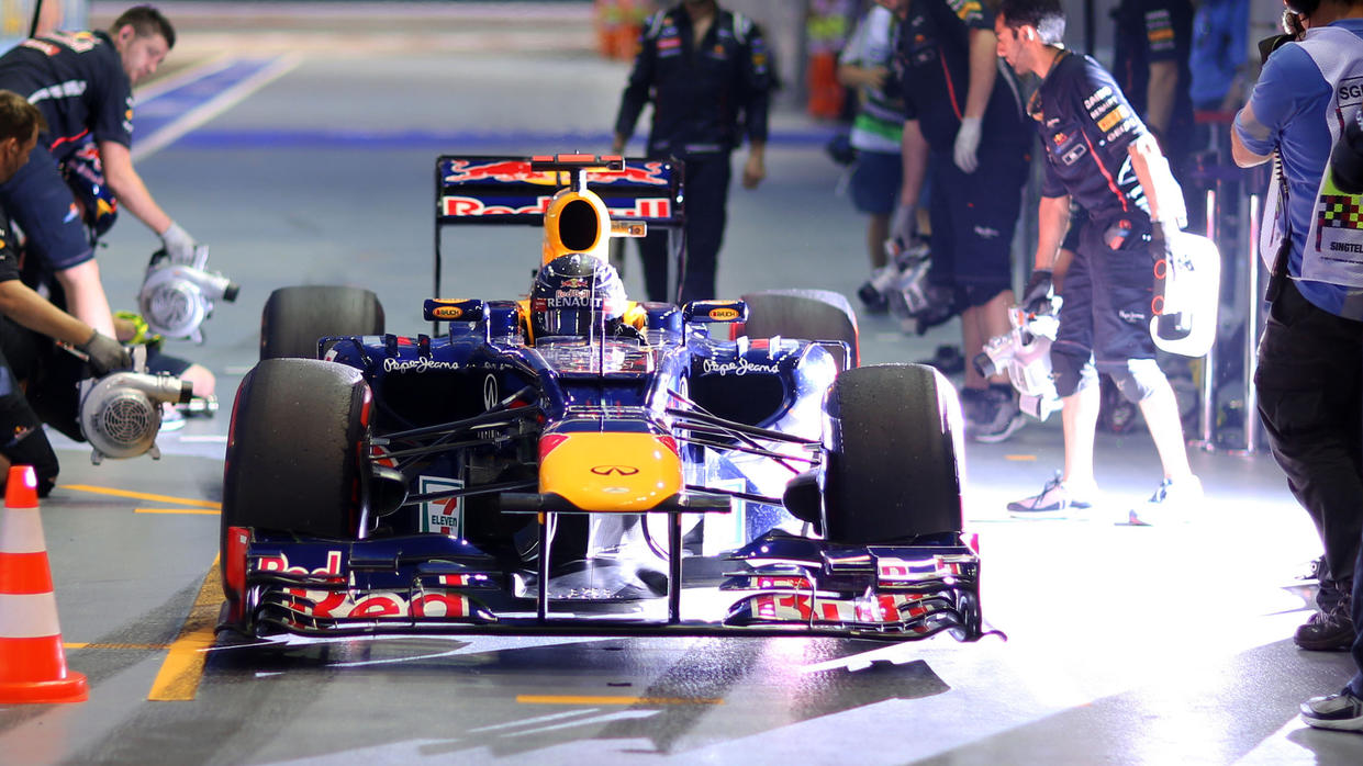German Formula One driver Sebastian Vettel of Red Bull practices a pit stop during the third practice session at the race track Marina-Bay-Street-Circuit, Singapore, 22 September 2012. The Formula One Grand Prix of Singapore will take place on 23 Sep