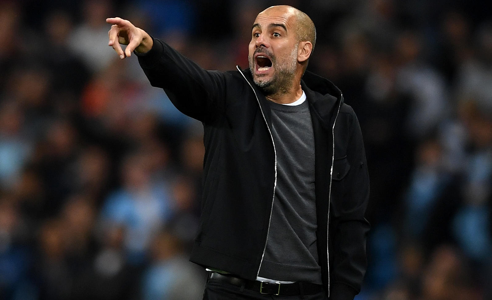 MANCHESTER, ENGLAND - OCTOBER 17:  Josep Guardiola, Manager of Manchester City gives his team instructions during the UEFA Champions League group F match between Manchester City and SSC Napoli at Etihad Stadium on October 17, 2017 in Manchester, Unit
