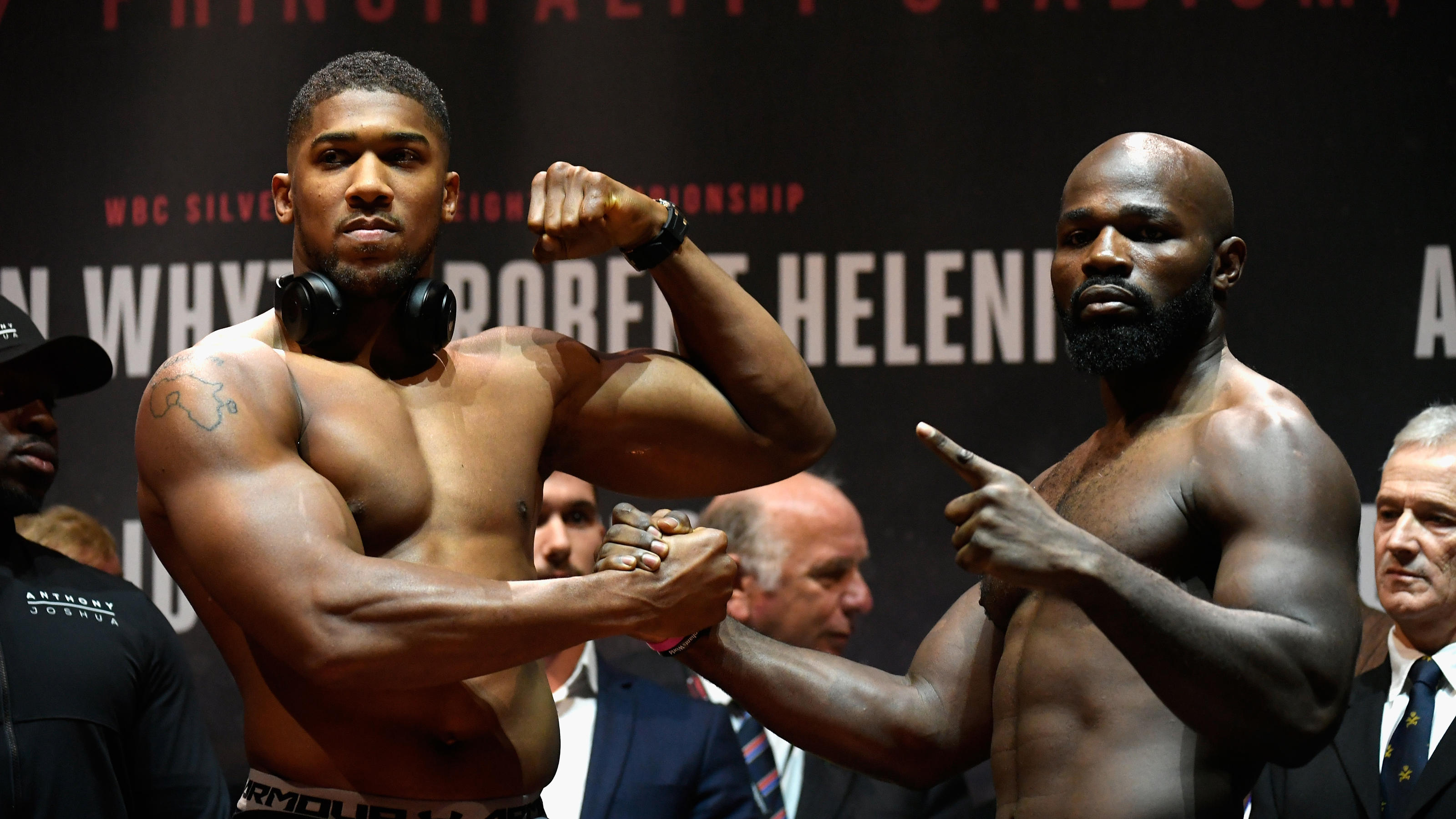 CARDIFF, WALES - OCTOBER 27:  Anthony Joshua of England (L) and Carlos Takam of France (R) pose for photos during a weigh-in prior to tomorrow's world heavyweight title fight between Anthony Joshua and Carlos Takam at Motorpount Arena on October 27,