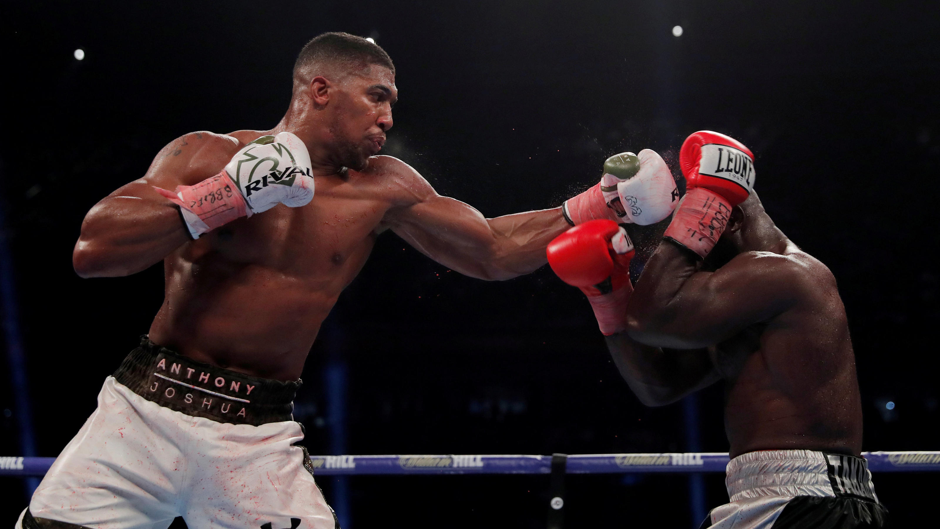 Boxing - Anthony Joshua vs Carlos Takam - IBF & WBA World Heavyweight Titles - Principality Stadium, Cardiff, Britain - October 28, 2017   Anthony Joshua in action against Carlos Takam   Action Images via Reuters/Andrew Couldridge     TPX IMAGES OF T