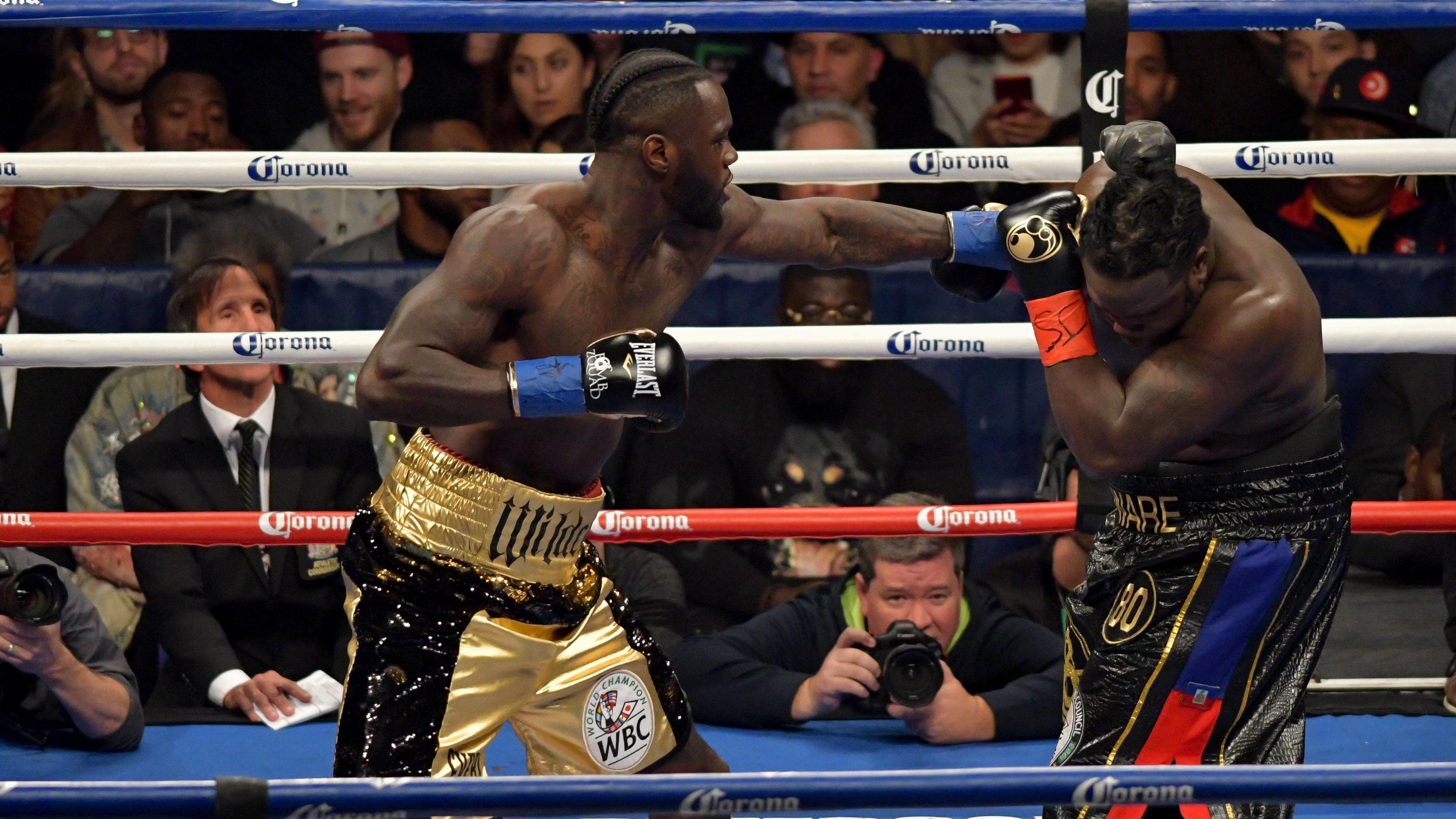 November 4, 2017 - Brooklyn, New York, USA - DEONTAY WILDER (gold trunks) and BERMANE STIVERNE battle in a heavyweight title bout at the Barclays Center in Brooklyn, New York. Boxing 2017 - Deontay Wilder Defeats Bermane Stiverne by 1st Round TKO PUB