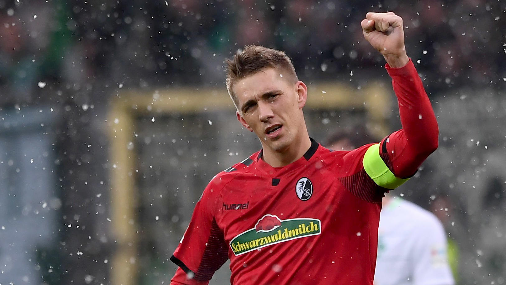 FREIBURG GERMANY - FEBRUARY 17: Nils Petersen of SC Freiburg celebrates his opening goal during the Bundesliga match between Sport-Club Freiburg and SV Werder Bremen at Schwarzwald-Stadion on February 17, 2018 in Freiburg, Germany.  (Photo by Michael