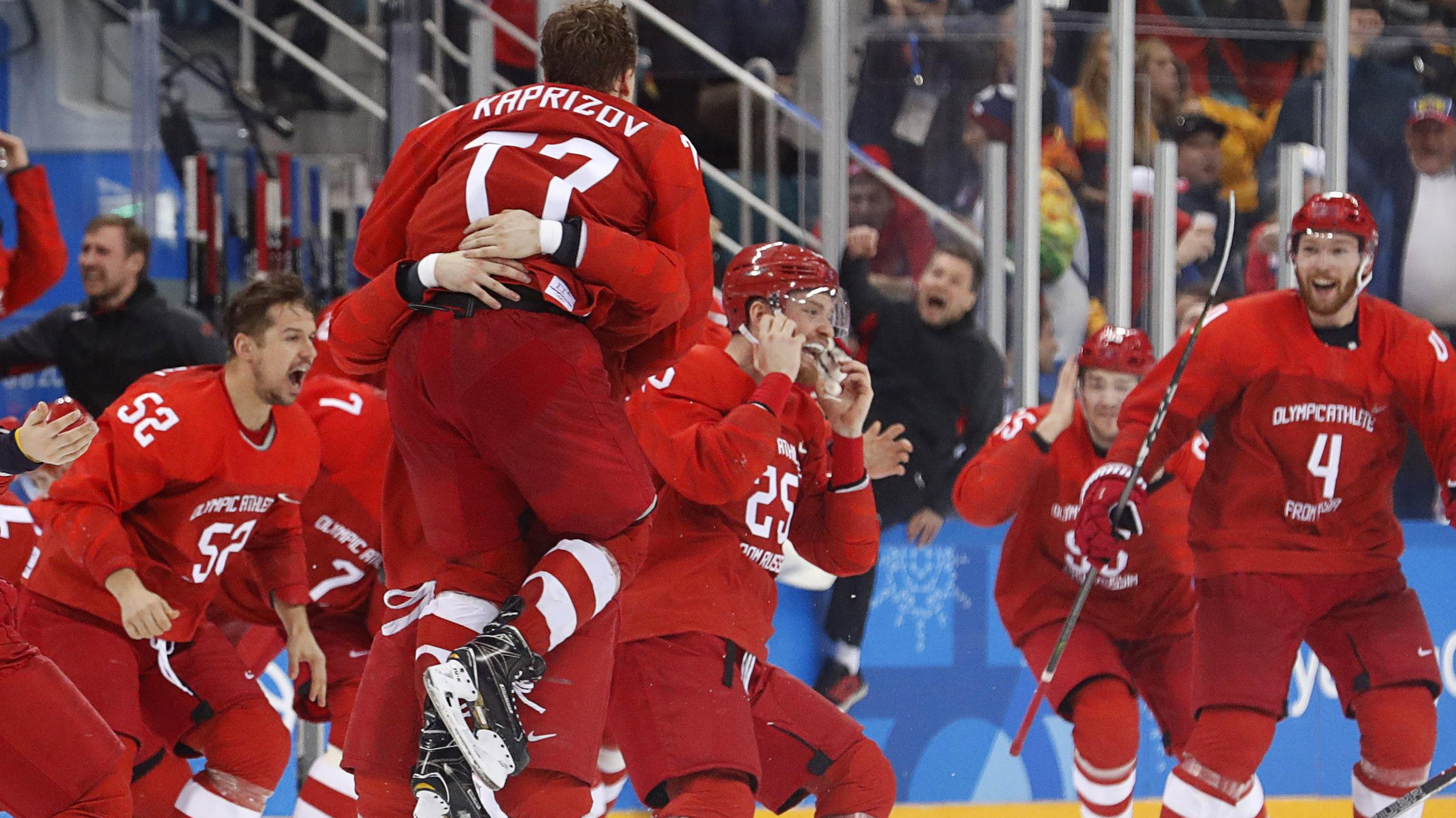 Ice Hockey - Pyeongchang 2018 Winter Olympics - Men's Final Match - Russia - Germany - Gangneung Hockey Centre, Gangneung, South Korea - February 25, 2018 - Olympic Athlete from Russia Kirill Kaprizov reacts with teammates after scoring a goal. REUTE