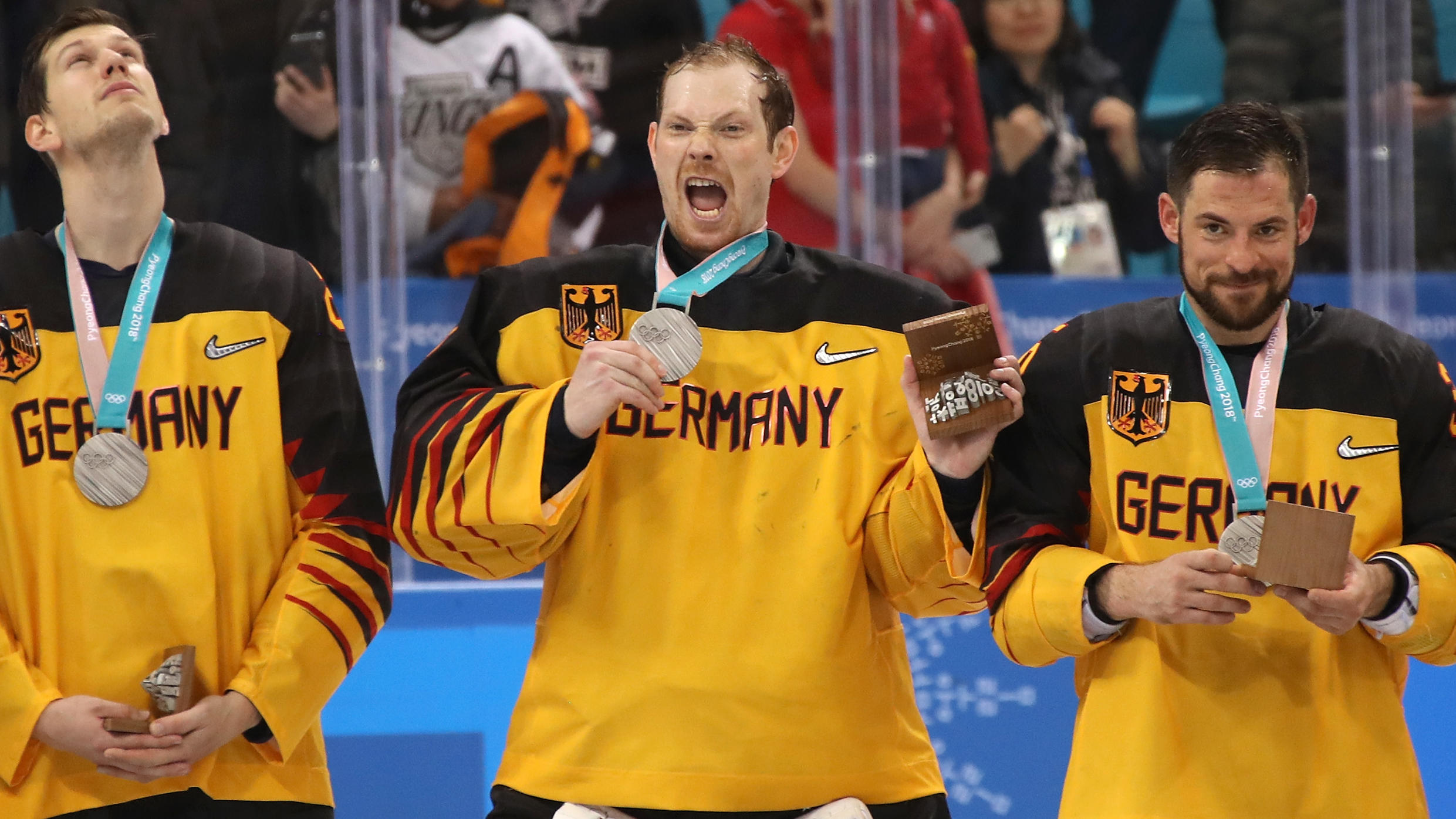GANGNEUNG, SOUTH KOREA - FEBRUARY 25: Silver medal winners Frank Mauer #28, Danny Aus Den Birken #33 and Yannic Seidenberg #36 of Germany react during the medal ceremony for the Men's Gold Medal Game against Olympic Athletes from Russia on day sixtee