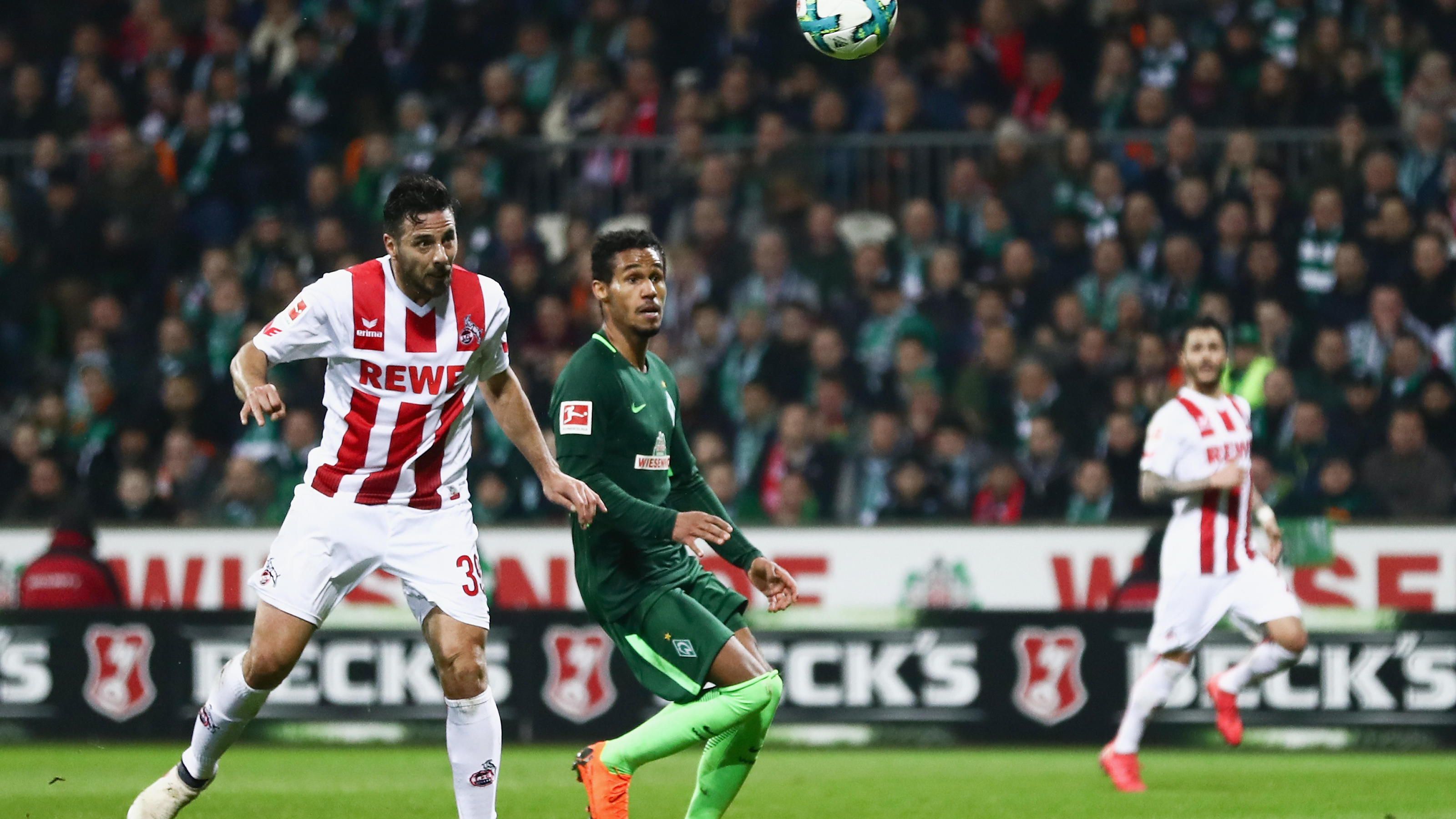 BREMEN, GERMANY - MARCH 12: Claudio Pizarro of Koeln misses a chance to score against Theodor Gebre Selassie of Bremen during the Bundesliga match between SV Werder Bremen and 1. FC Koeln at Weserstadion on March 12, 2018 in Bremen, Germany.  (Photo