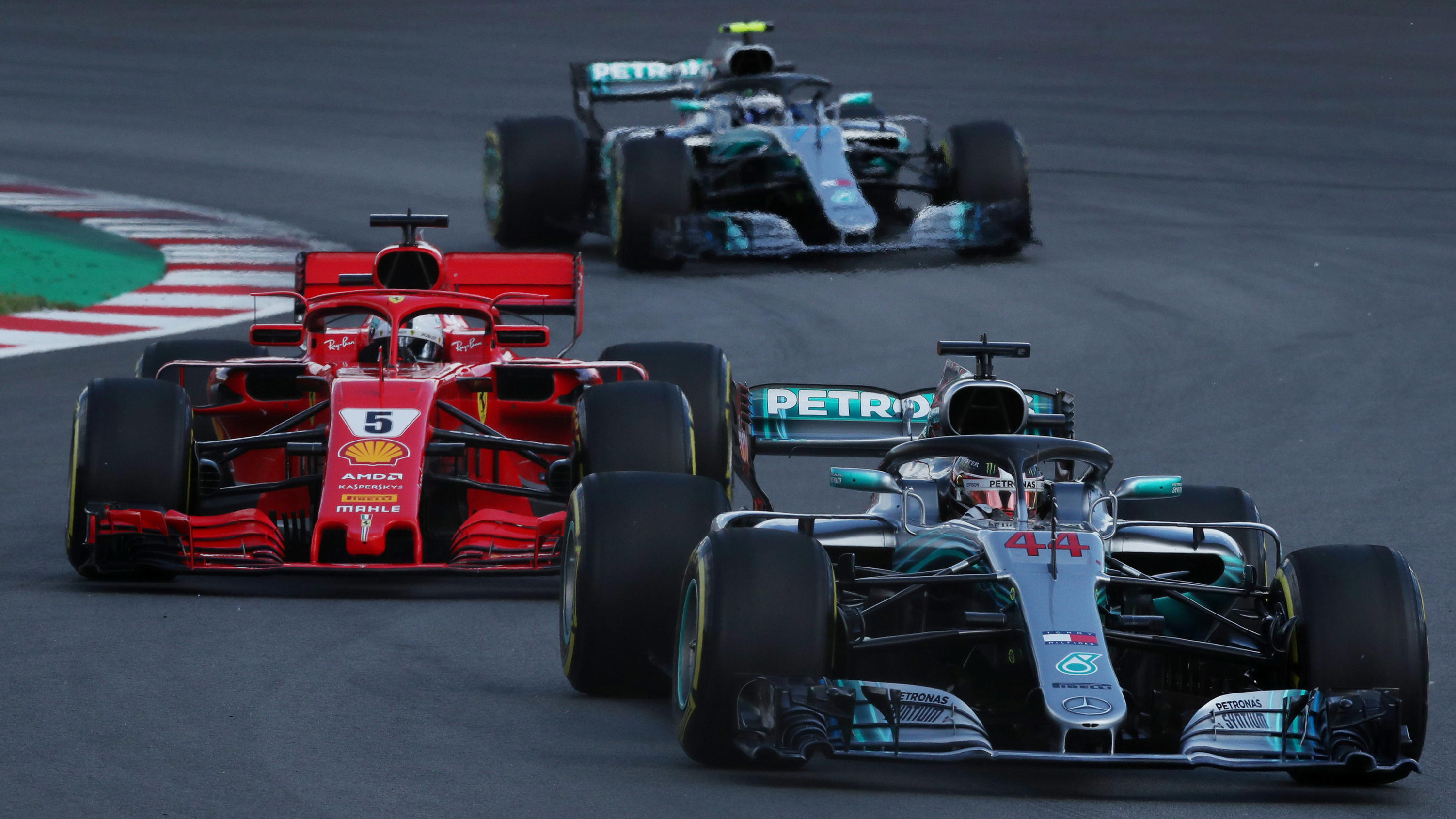Formula One F1 - Spanish Grand Prix - Circuit de Barcelona-Catalunya, Barcelona, Spain - May 13, 2018   Mercedes' Lewis Hamilton leads Ferrari's Sebastian Vettel and Mercedes' Valtteri Bottas behind the safety car (not pictured) during the seco