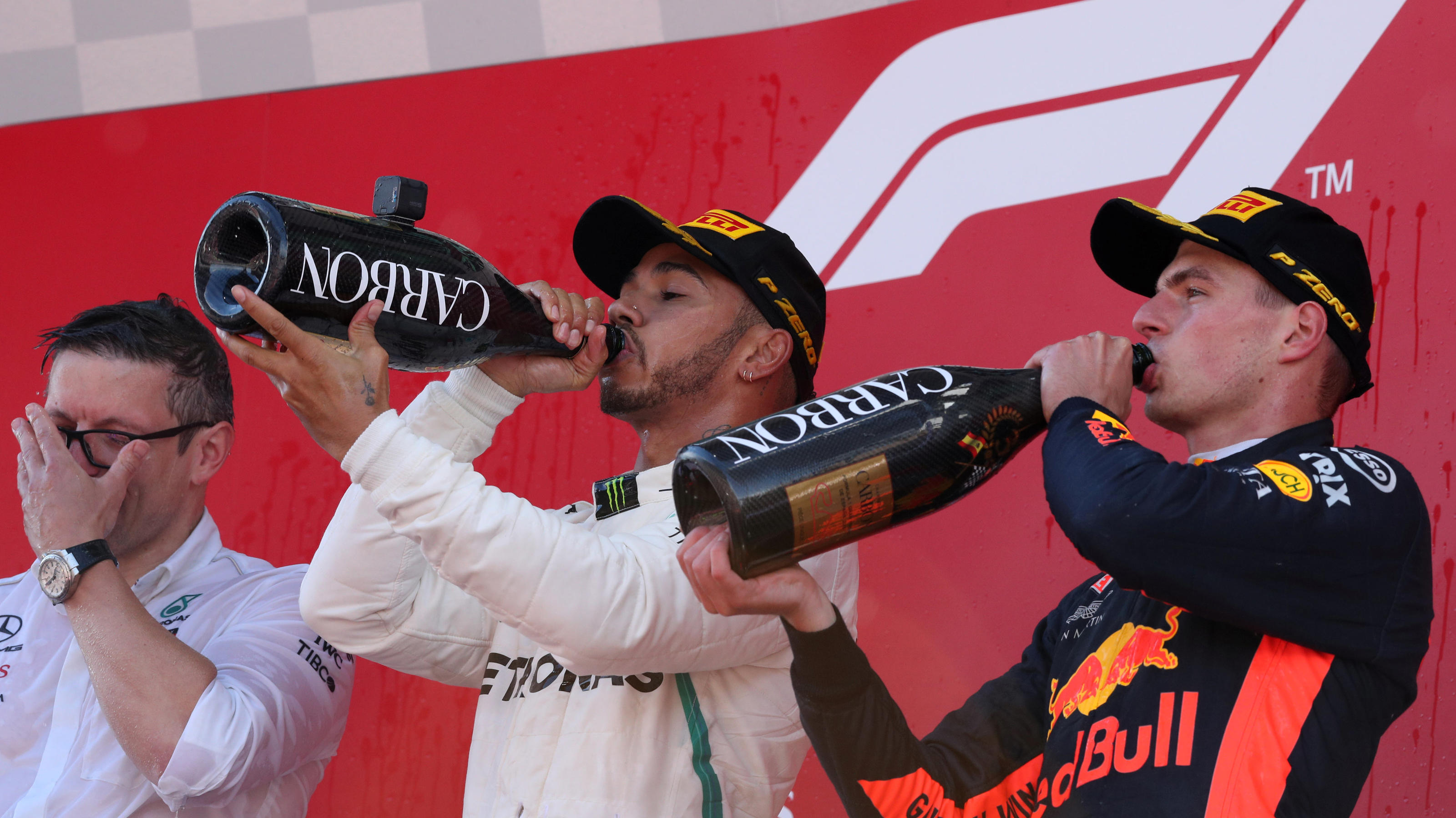 Formula One F1 - Spanish Grand Prix - Circuit de Barcelona-Catalunya, Barcelona, Spain - May 13, 2018   Mercedes' Lewis Hamilton and Red Bull's Max Verstappen drink champagne as they celebrate on the podium after finishing first and third respect
