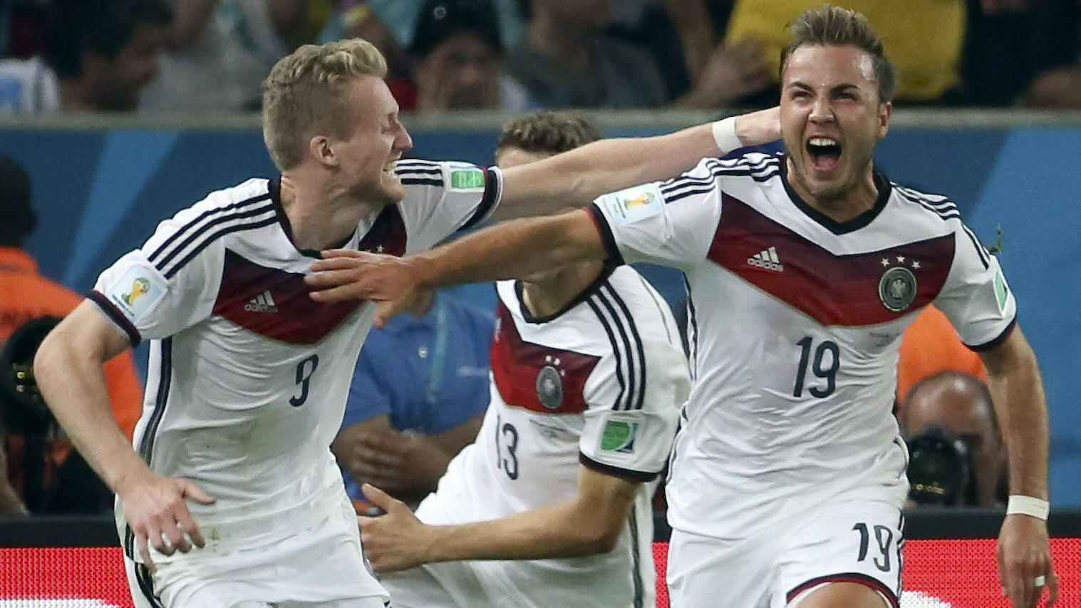 FILE - epa04314829 Mario Goetze (R) of Germany is celebrated by Andre Schuerrle (L) after scoring the winning goal during the FIFA World Cup 2014 final between Germany and Argentina at the Estadio do Maracana in Rio de Janeiro, Brazil, 13 July 2014.