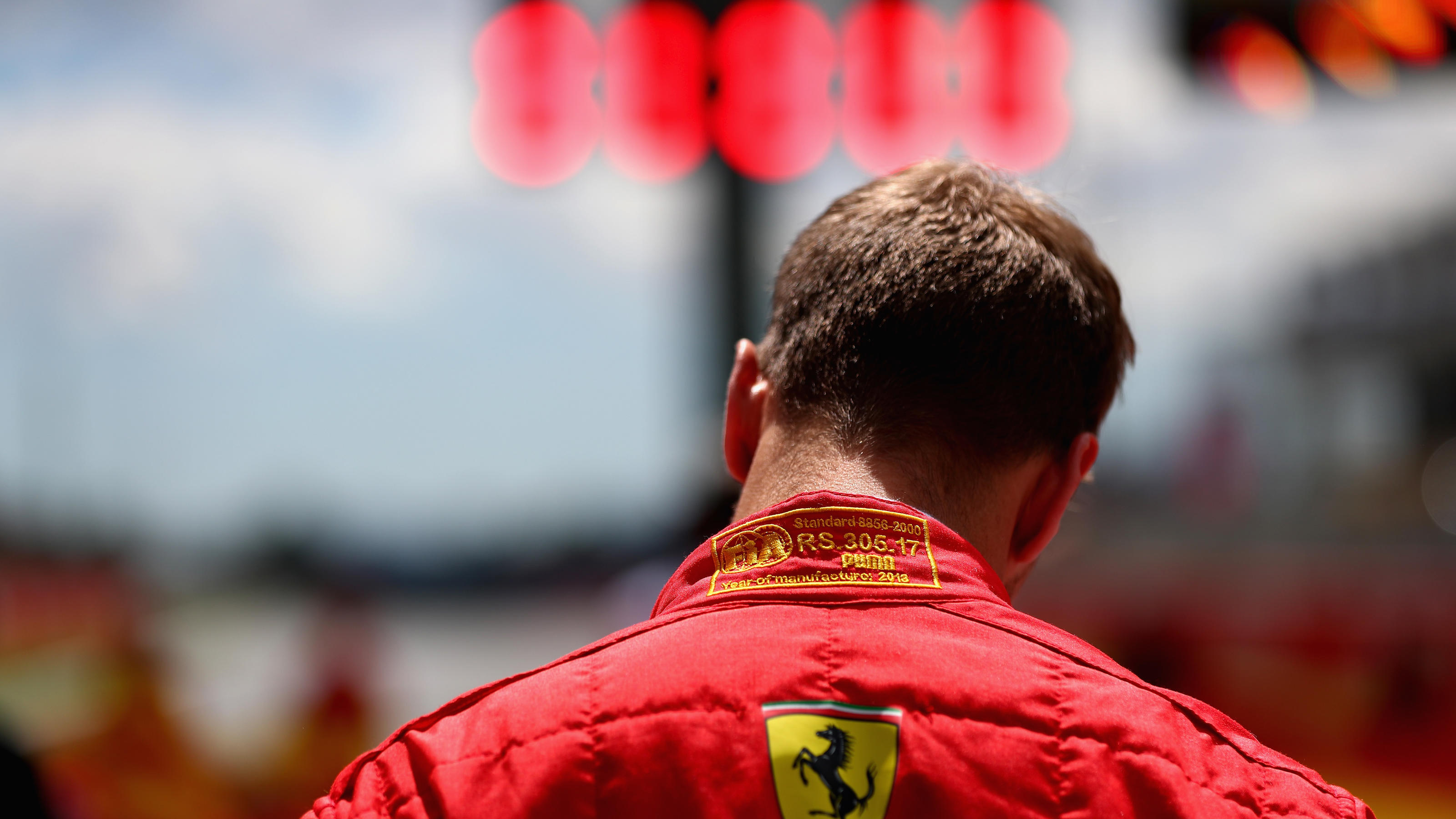 MONTMELO, SPAIN - MAY 13: Sebastian Vettel of Germany and Ferrari on the grid before the Spanish Formula One Grand Prix at Circuit de Catalunya on May 13, 2018 in Montmelo, Spain.  (Photo by Mark Thompson/Getty Images)