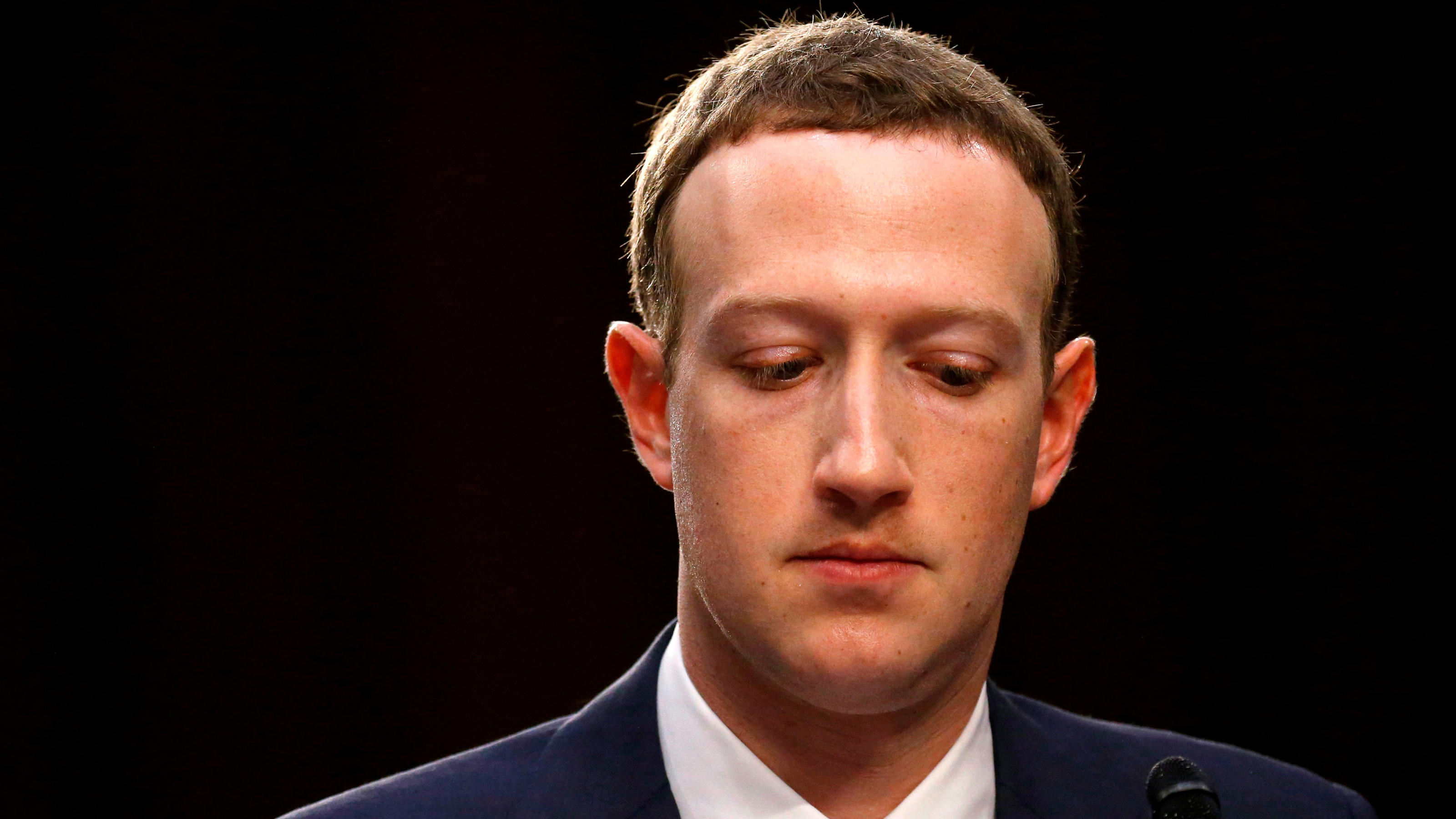 FILE PHOTO: Facebook CEO Mark Zuckerberg listens while testifying before a joint Senate Judiciary and Commerce Committees hearing regarding the company's use and protection of user data, on Capitol Hill in Washington, U.S., April 10, 2018. Picture