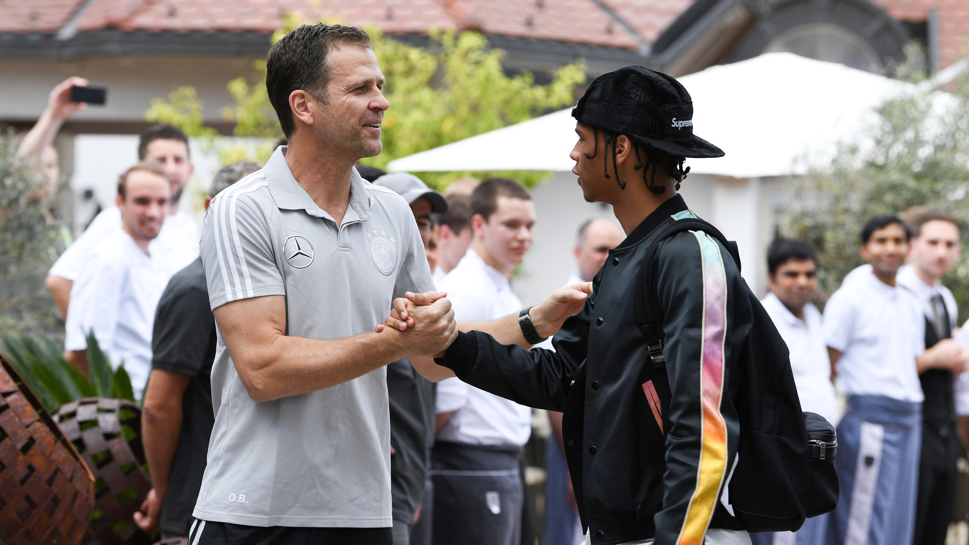 Soccer Football - FIFA World Cup - Germany Training - Eppan, Italy - May 23, 2018   German team manager Oliver Bierhoff welcomes Leroy Sane         Markus Gilliar/Pool via Reuters